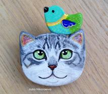 Gray cat with bird