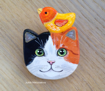 Three color cat with bird